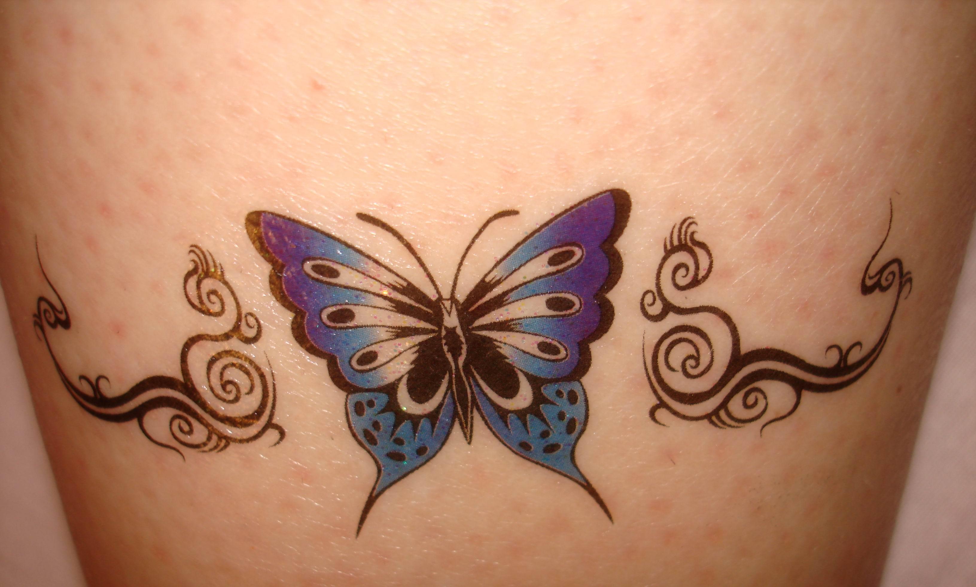 Фото женских татуировок на интимной зоне